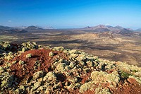 View of Santa Catalina volcano and El Cuervo volcano from Caldera Colorada volcano, in The Volcanoes Natural Park  Tinajo, Lanzarote, Las Palmas provi...