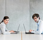 Two Businesspeople using laptops