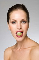 female beauty with grape in mouth