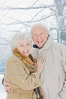Couple hugging in snow