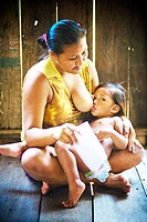 Mother Breastfeeding the Son, Bom Jesus Community, Negro River, Novo Airão, Amazonas, Brazil