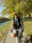Woman riding bicycle in Autumn
