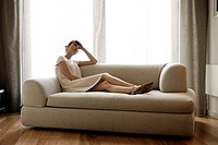 Woman lying down on sofa