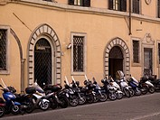Motorcycles parked in front of old building, Rome, Italy