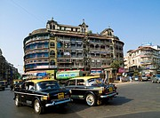Taxis driving on street, Mumbai, India