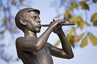 A statue of a boy playing a piccalo