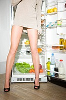 woman looking into fridge