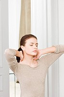 woman massaging neck