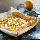Quark and pumpkin tart with rosemary on baking parchment
