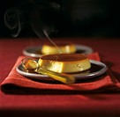Two crème caramels with smoke