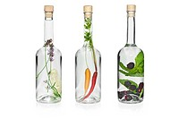 Bottles with herbs and fruits