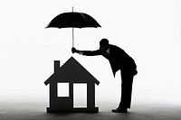 Man protecting a house with an umbrella
