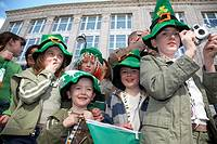 group of young children standing waiting on the parade and carnival on st patricks day belfast northern ireland