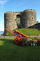 Carrickfergus Castle sits on the shore of Belfast, built by John de Courcy in 1177 as his headquarters, after he conquered eastern Ulster  County Antr...