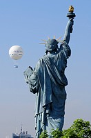 France, Paris, replica of the Statue of Liberty by sculptor Bartholdi situated on Allee des Cygnes and the captive balloon of the Andre Citroen Park