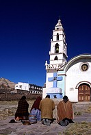 Bolivia, Potosi Department, Sur Lipez Province, Indians praying in front of a church