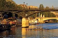 France, Paris, banks of the Seine river listed as World Heritage by UNESCO, Passerelle des Arts Arts Footbridge, rowing
