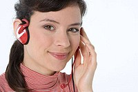 Portrait of a female customer service representative wearing a headset and smiling