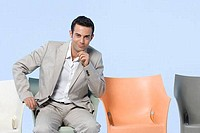 Businessman sitting in a chair with his hand on his chin