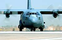 A C-130 Hercules taxis in after an Operation Iraqi Freedom mission at Balad Air Base Iraq  The C-130 is deployed from the 439th Airlift Wing Air Natio...