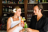 Close_up of a couple toasting with cocktail glasses, Papeete, Tahiti, French Polynesia