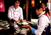 China, Yunnan province, Lijiang, listed as World Heritage by UNESCO, restaurant