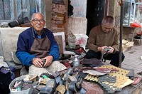 China, Shandong province, Qingdao, shoemaker in the old town