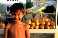 Vietnam, Phu Quoc island, young boy in the port of Duong Dong