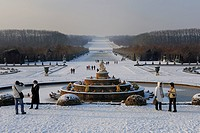France, Yvelines, snow covered park of the Chateau de Versailles, listed as World Heritage by UNESCO, the Latona Basin and gardens perspective and the...
