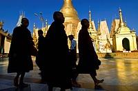 Myanmar Burma, Yangon Division, Yangon, Singuttara hill, pilgrims inside the Shwedagon pagoda