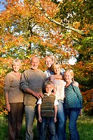 Three generation family in autumn setting