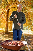 Man doing yard work in autumn
