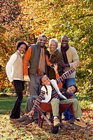 Three generation african family outdoors in autumn