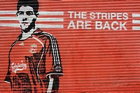 United Kingdom, Liverpool, football player painted on an iron curtain of the local football club