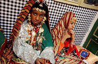 Girls wearing traditional dresses, old town Date Festival, Ghadamis, Libya