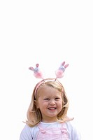 Girl wearing bunny rabbit headband, smiling, portrait, cut out