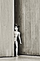 male doll in doorway