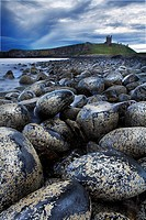 Pebbles and stones and a castle on a hill