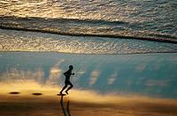 Jericoacoara (Ceara, Brazil): a man jogging at sunset along the beach