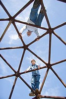 father and son climb geodome
