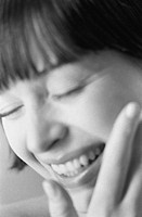 A close up of a young woman laughing