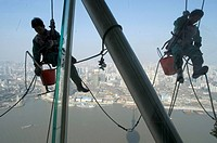 China, Shanghai, Pudong business district, the Oriental Pearl TV Tower by Shanghai Modern Architectural Design Co. Ltd, window cleaners