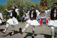 New York City (USA): Greek-American men dancing sirtaki at Grand Army Plaza, in front of the Plaza Hotel, before the Greek Parade