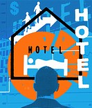 Businessman looking at hotel sign