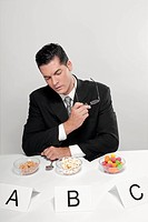 Businessman examining food samples