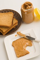 Peanut butter jar with bread slices