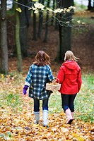 Mother and daughter walking in a forest Stockholm Sweden.
