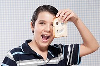 Boy holding a slice of bread