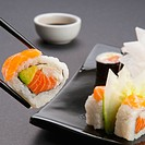 Close_up of sushi held with chopsticks