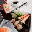 Close_up of sushi with chopsticks and soy sauce